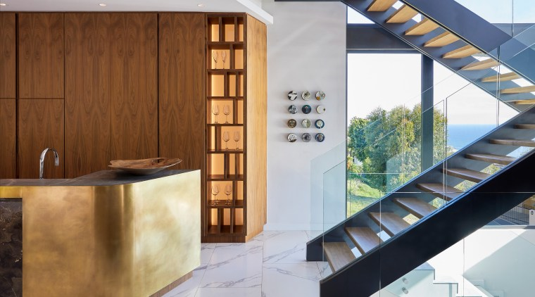 A double‐volume‐glass stairwell introduces mountainscape views. architecture, building, ceiling, design, floor, flooring, furniture, home, house, interior design, material property, property, real estate, room, stairs, tile, wall, wood, brown