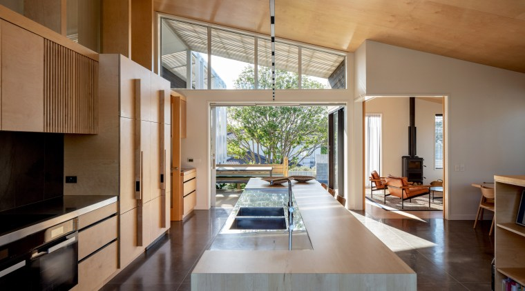 The transparency through the home's main gable provides
