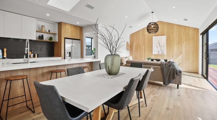 The open-plan entertainer's wing includes a modern wood