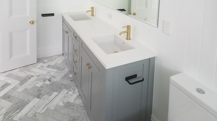 A marble border in the shower floor is bathroom, bathroom accessory, bathroom cabinet, bathroom sink, floor, plumbing fixture, room, sink, tap, tile, white, gray