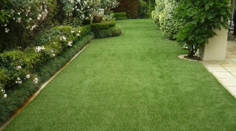 Residential landscape artificial turf, backyard, flooring, garden, grass, grass family, landscape, landscaping, lawn, plant, shrub, walkway, yard, green, brown