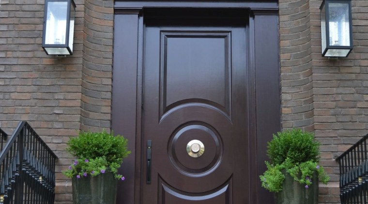 The front entrance harkens back to the home's arch, door, facade, home, window, gray, black