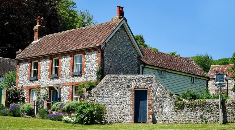 An outside view of a traditional British home almshouse, building, cottage, estate, facade, farmhouse, home, house, mansion, property, real estate
