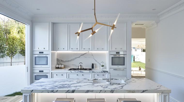 Marble countertops meet marble-look porcelain wall tiles in countertop, cuisine classique, interior design, kitchen, gray