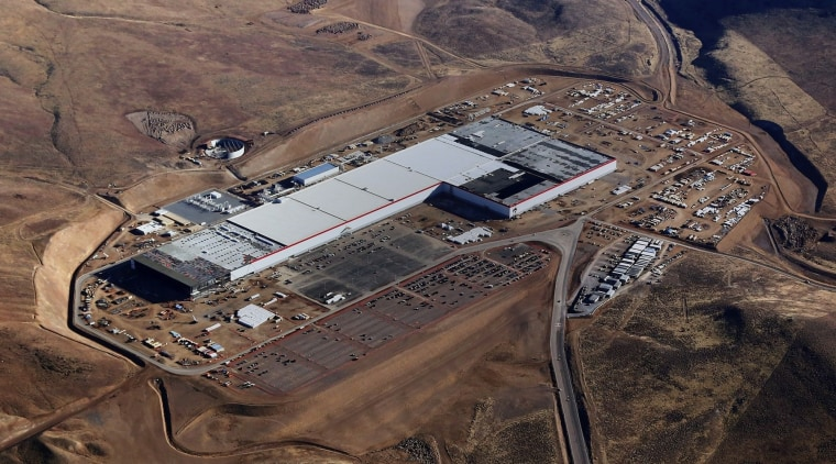 Construction underway on the Gigafactory aerial photography, bird's eye view, brown, black, gray