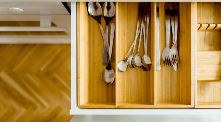 Don't underestimate drawer storage; it can be just cabinetry, furniture, shelf, shelving, wood, yellow, brown, orange
