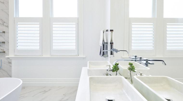 A double basin vanity treads a line between bathroom, bathroom accessory, bathroom sink, home, interior design, plumbing fixture, product, room, sink, tap, window, white