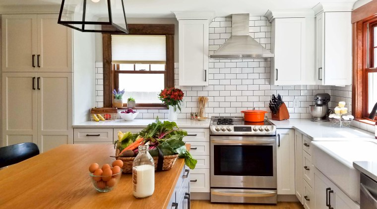 White, NY deli-like tiles form the splashback and cabinetry, countertop, cuisine classique, floor, flooring, hardwood, home, interior design, kitchen, laminate flooring, living room, room, wood flooring, white