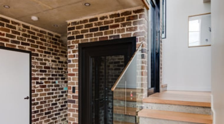 Recycled brick means the home has a touch architecture, brick, ceiling, daylighting, floor, flooring, handrail, hardwood, home, house, interior design, loft, real estate, stairs, wall, wood, wood flooring, gray