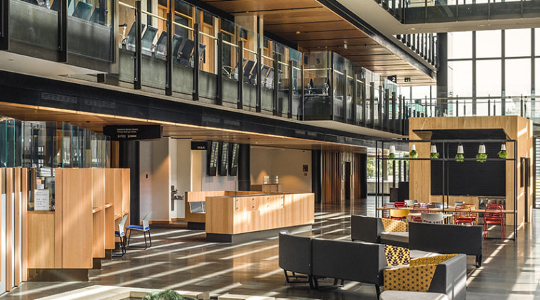 Home to the public cafe, the glass-walled atrium architecture, building, black