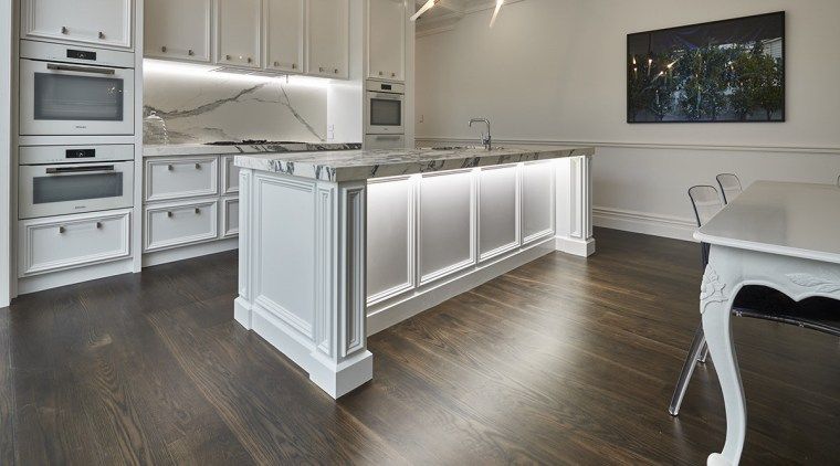 Concealed underbench lighting shows off the classic detailing countertop, floor, flooring, hardwood, kitchen, laminate flooring, room, tile, wood, wood flooring, gray
