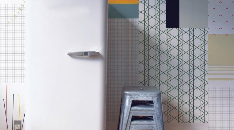 Cut & paste 墙纸是一种简单易上手的装饰墙面的方法。 chair, floor, flooring, furniture, interior design, product, product design, table, tile, wall, gray, white
