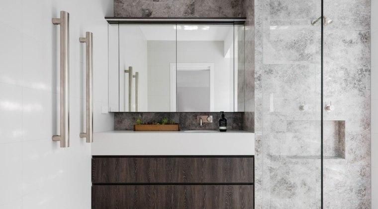 A true five-star bathroom, it features a floating bathroom, bathroom cabinet, floor, flooring, interior design, sink, white