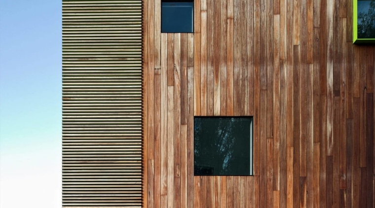 Interspaced windows break up the wood facade architecture, building, facade, home, house, siding, wall, wood, wood stain