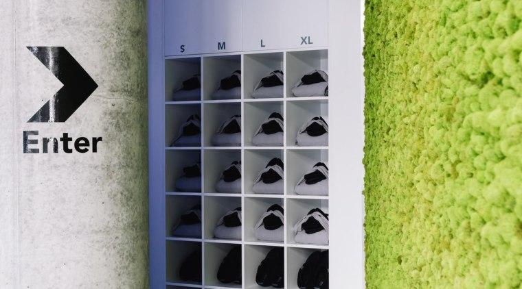 The green moss walls runs alongside the entrance wall, gray