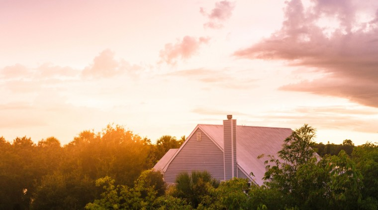 Did you know the roof increases curb appeal? afterglow, atmosphere, cloud, dawn, dusk, evening, field, grass, horizon, landscape, morning, red sky at morning, rural area, sky, sunlight, sunrise, sunset, tree, white, brown