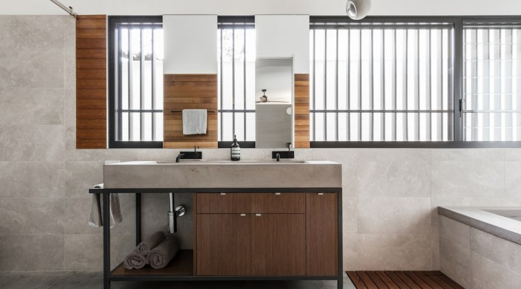 Stone, wood and tile feature throughout the bathroom bathroom, bathroom accessory, bathroom cabinet, cabinetry, floor, furniture, interior design, product design, sink, white, gray