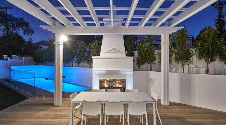 Even the outdoor fireplace has classic detailing in architecture, backyard, estate, home, house, interior design, lighting, outdoor structure, patio, property, real estate, roof, gray
