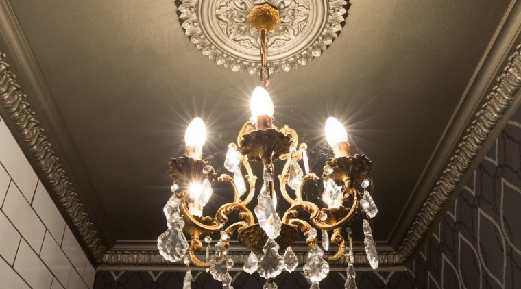 Chandelier and patterned wallpaper in powder room designed ceiling, chandelier, decor, light, light fixture, lighting, wall, black, brown