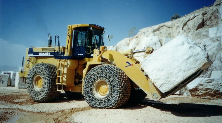 SCE Stone & Design source high-quality quarried stone bulldozer, construction equipment, snow, vehicle, yellow, white