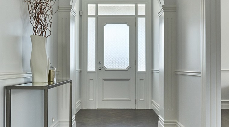 A herringbone floor in the entry hall provides architecture, ceiling, floor, flooring, furniture, home, interior design, molding, structure, wall, window, gray