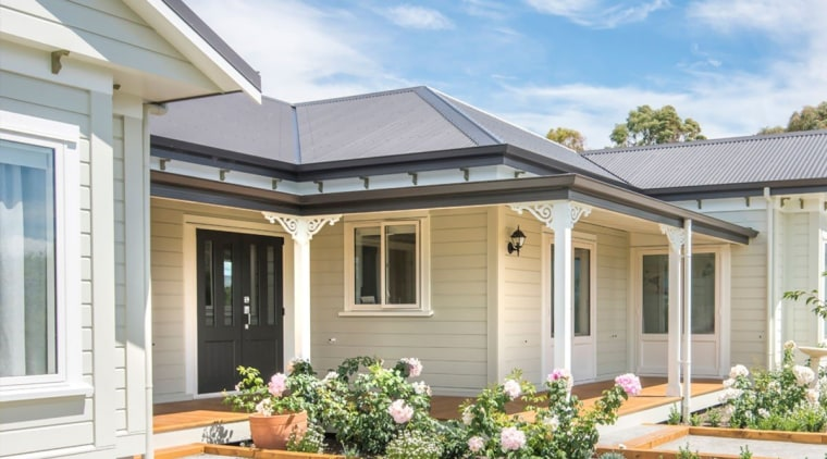Rusticated Envira weatherboard home by David Wraight. cottage, elevation, estate, facade, home, house, porch, property, real estate, residential area, roof, siding, window, gray, white