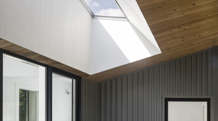 A skylight merges with the soffit architecture, ceiling, daylighting, home, house, interior design, lighting, real estate, roof, window, white, black