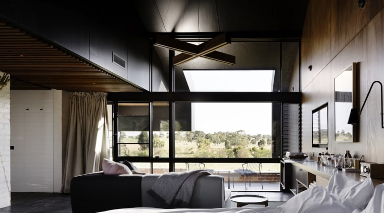 The dark ceilings make the space feel much architecture, ceiling, house, interior design, window, black