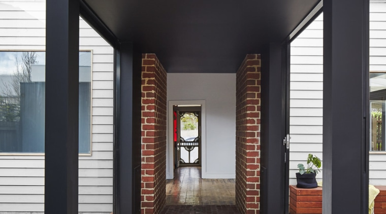 Looking through the tunnel into the old part architecture, door, floor, interior design, lobby, structure, black, gray, white