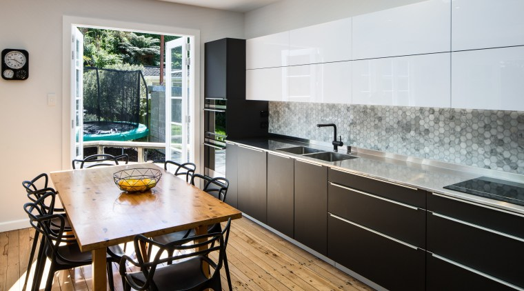White gloss cabinets contrast with the more muted countertop, interior design, kitchen, real estate, room, gray