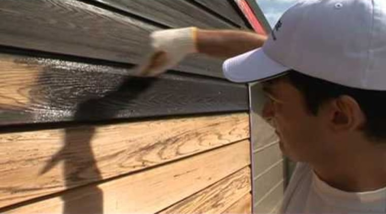 Learn how to stain weatherboards with Resene Woodmsan. floor, material, wood, black