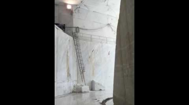Walking through a marble quarry in Italy - column, phenomenon, sculpture, structure, tourist attraction, black
