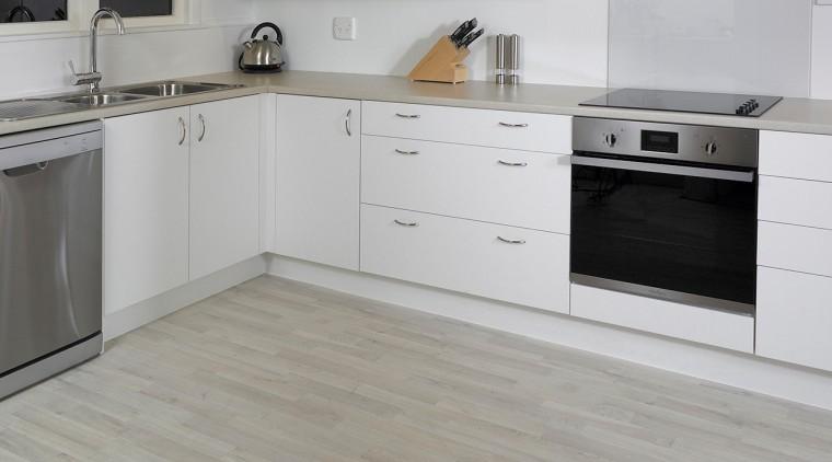 Cork is a warm, affordable floor option cabinetry, countertop, cuisine classique, floor, flooring, furniture, hardwood, kitchen, laminate flooring, product, tile, wood, wood flooring, gray