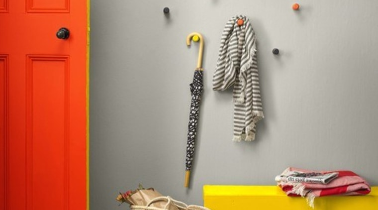 Photo by Melanie Jenkins, styling by LeeAnn Yare. floor, furniture, interior design, orange, room, shelf, shelving, table, wall, yellow, gray