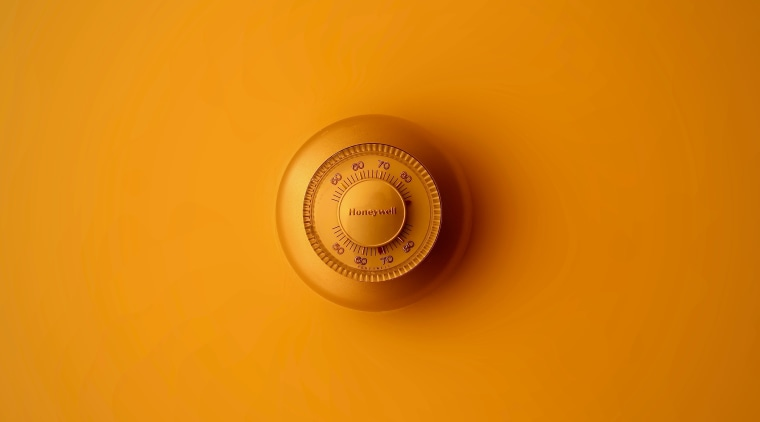 Have you considered a smart thermostat? close up, macro photography, yellow, orange