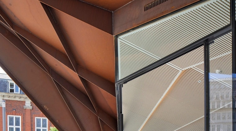 The internal soffit mimics the external form. architecture, ceiling, daylighting, roof, structure, red