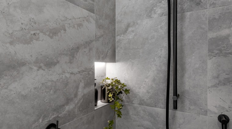 Concealed lighting makes a feature of the bathroom's