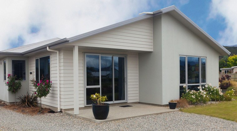 Low maintenance cladding on bungalow-style house in Queenstown cottage, elevation, facade, home, house, property, real estate, siding, window, gray