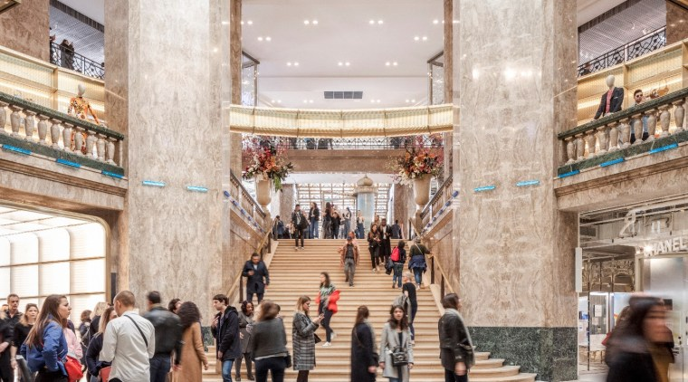 A grand staircase, which doubles as an auditorium architecture, building, city, interior design, lobby, shopping, shopping mall, tourism, gray