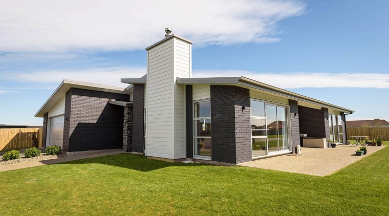Dark bricks and weatherboard mixed for a striking architecture, cottage, elevation, facade, home, house, property, real estate, residential area, white