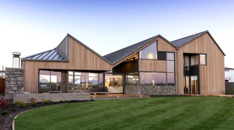 The home's architectural form includes three strong gable