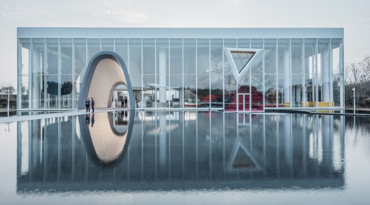 This project is situated at the intersection of architecture, automotive wheel system, product, reflection, water, water feature, wheel, gray
