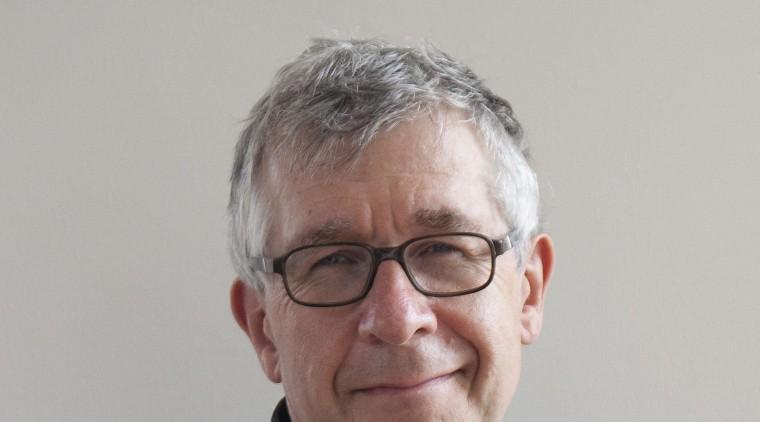 Renowned British kitchen designer, author and educator – businessperson, sitting, gray, black