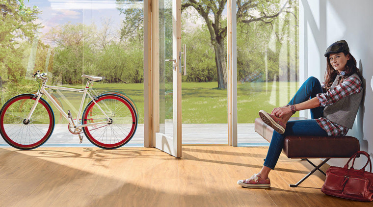 Healthy DISANO flooring by Haro Quality Flooring bicycle, bicycle part, bicycle wheel, floor, flooring, furniture, leisure, room, vehicle, window, wood flooring, orange