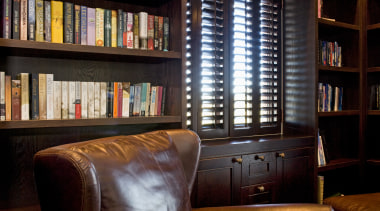 Image of dark stained library shelving and cabinetry bookcase, furniture, interior design, library, shelving, window, black