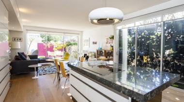 Designer-owner Jane Agnew chose a simple palette of apartment, home, interior design, living room, real estate, gray