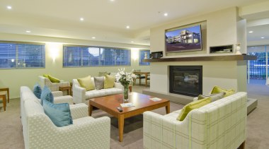 Bupa Parklands on Papanui Village features a wide estate, home, interior design, living room, real estate, room, orange, yellow