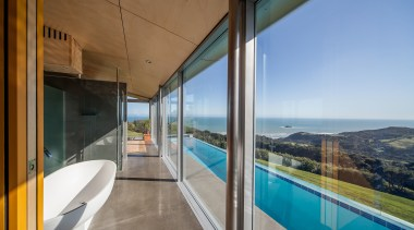 In this clifftop house, each glass panel is apartment, architecture, estate, home, house, interior design, property, real estate, sky, window, gray, brown