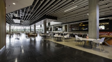 A state-of-the-art food hall is at the heart food court, interior design, lobby, black, gray