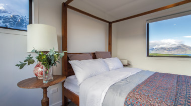 High-quality finishes and flooring in subdued tones ensure bedroom, real estate, room, suite, gray